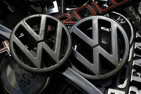 Old Volkswagen emblems are displayed with other car companies logos at antique market in Olszyny near Szczytno, northern Poland July 22, 201