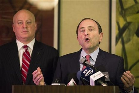 National Hockey League (NHL) Commissioner Gary Bettman gestures in front of NHL deputy commissioner Bill Daly (L) as he describes negotiatio