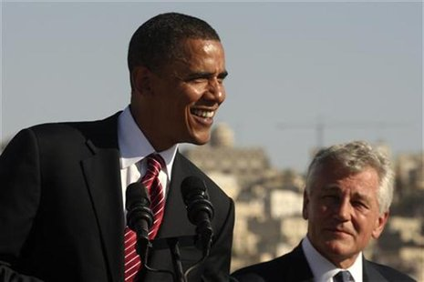 President Barack Obama (L) smiles next to Chuck Hagel (R-NE) during a news conference at the Amman Citadel, an ancient Roman landmark, in Am