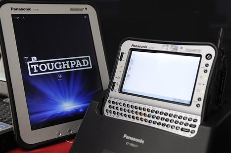 Panasonic Toughpad (L) and handheld Toughbook model are displayed at the company's IT products headquarters in Moriguchi, western Japan Dece