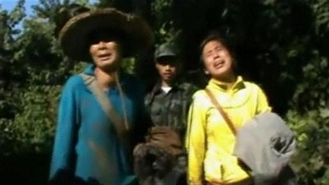 Evacuees react after being received by Kachin's soldiers in Kachin state in this still image taken from a video dated December 28, 2012. REU