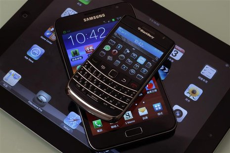 (From top to bottom) A Blackberry Bold smartphone, a Samsung Galaxy Note phablet, and an Apple iPad 2 tablet are displayed in this illustrat