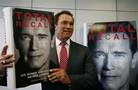 Actor and former California governor Arnold Schwarzenegger presents his book 'Total Recall' during a news conference during the book fair in