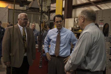 Left, L&S Exec. VP Paul Gullickson.  Center, WI Governor Scott Walker