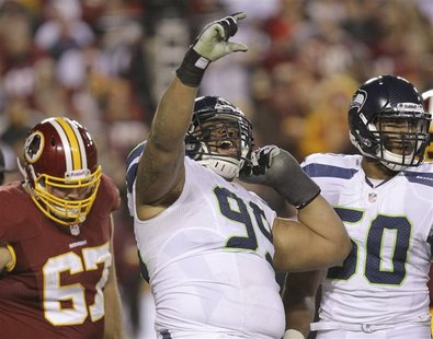 Seattle Seahawks defensive tackle Alan Branch (99) celebrates his second half sack on Washington Redskins quarterback Robert Griffin III (10