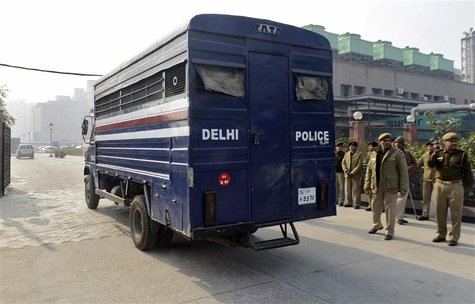 A police van carrying five men accused of the gang rape and murder of an Indian student arrives at a court in New Delhi January 7, 2013. Fiv
