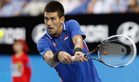 Novak Djokovic of Serbia hits a return to Fernando Verdasco of Spain during their men's singles match at the Hopman Cup tennis tournament in