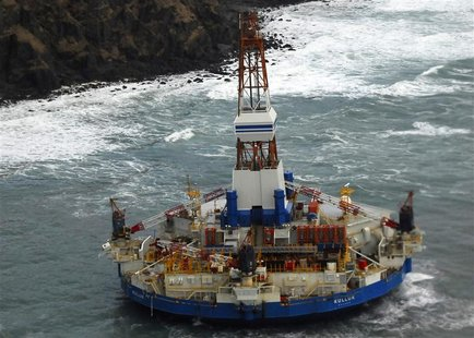 The conical drilling unit Kulluk sits grounded 40 miles (64 kms) southwest of Kodiak City, Alaska in this U.S. Coast Guard handout photo tak