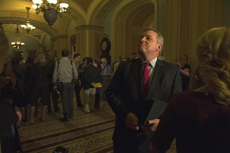 Sen. Dick Durbin (D-IL) speaks to reporters after leaving the Mansfield Room following a caucus meeting at the U.S. Capitol in Washington De