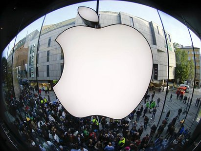 Customers gather outside an Apple store before the release of iPhone 5 in Munich early September 21, 2012. Apple Inc's iPhone 5 hit stores a
