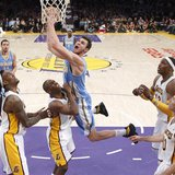 Denver Nuggets' Danilo Gallinari (C) of Italy shoots over Los Angeles Lakers', (L-R) Jordan Hill, Jodie Meeks, Dwight Howard and Steve Nash