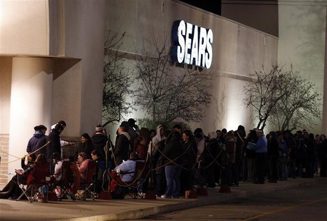 People wait outside a Sears store on the Thanksgiving Day holiday in Manchester, New Hampshire November 22, 2012. REUTERS/Jessica Rinaldi