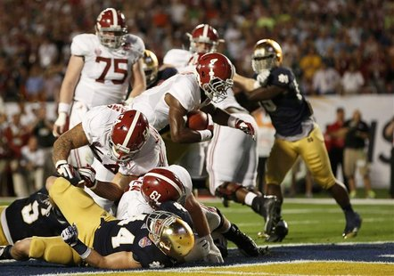 Alabama Crimson Tide running back T.J. Yeldon (4) scores a touchdown against the Notre Dame Fighting Irish in the second quarter of their NC