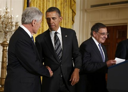 U.S. President Barack Obama (C) greets his Defense Secretary-nominee, former U.S. Senator Chuck Hagel, as current Defense Secretary Leon Pan