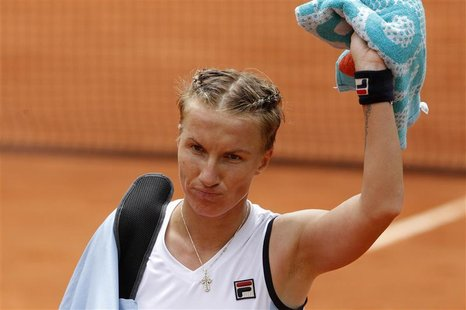 Svetlana Kuznetsova of Russia leaves the court after losing her match against Sara Errani of Italy during the French Open tennis tournament