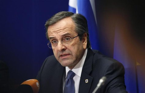 Greece's Prime Minister Antonis Samaras holds a news conference at the end of a European Union leaders summit, in Brussels December 14, 2012