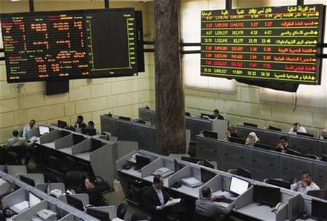 Traders work at the Egyptian stock exchange in Cairo January 3, 2013. REUTERS/Asmaa Waguih