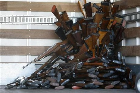 A small portion of guns that were turned in by their owners are stacked inside a truck at a gun buyback held by the Los Angeles Police Depar