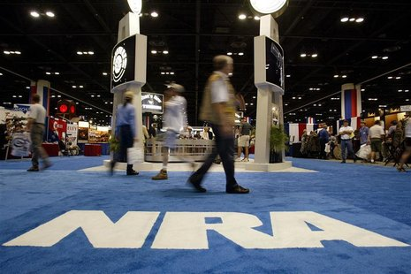 People walk inside the Orlando Convention Center at the 132nd Annual National Rifle Association Meeting in in Orlando, Florida April 27, 200