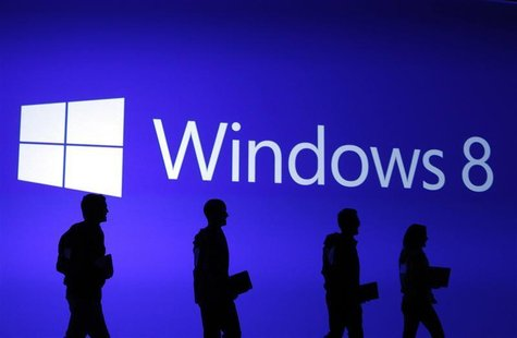 Guests are silhouetted at the launch event of Windows 8 operating system in New York, October 25, 2012. REUTERS/Lucas Jackson