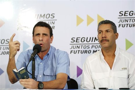 Venezuelan opposition governor of Miranda Henrique Capriles (L) speaks as governor of Lara Henri Falcon listens at a news conference in Cara