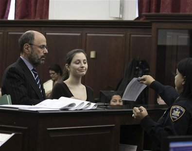 Morgan Gliedman (C) stands next to her lawyer Gerald Shargel (L) in Manhattan Criminal Court in New York January 8, 2013. REUTERS/Dan Brinza