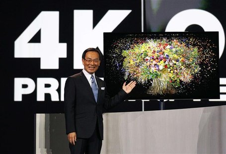 "Panasonic chief Kazuhiro Tsuga introduces the company's new 4K OLED 56"" television during the Panasonic opening day keynote at the Consumer"