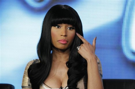 "Judge Nicki Minaj gestures during a Fox panel for the television series ""American Idol"" at the 2013 Winter Press Tour for the Television Cri"