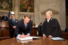 Leibham signs registry after being sworn in as President Pro Tempore