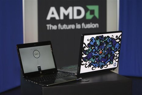 "A Hewlett-Packard Pavilion dv2 laptop with an AMD Yukon platform (L) is shown next to a laptop displaying the ""Engine Room"" Notebook Design"