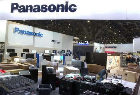 Workers prepare the Panasonic booth for the International CES show at the Las Vegas Convention Center in Las Vegas, Nevada January 4, 2013.