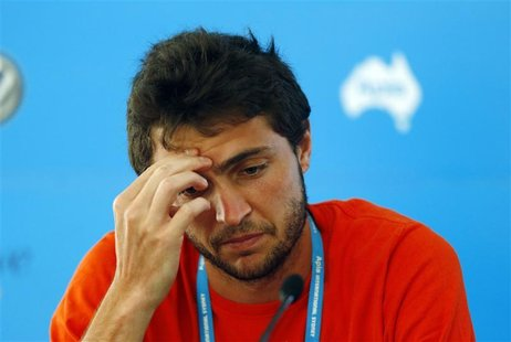 Gilles Simon of France talks during a news conference at the Sydney International tennis tournament January 9, 2013. Simon withdrew from the