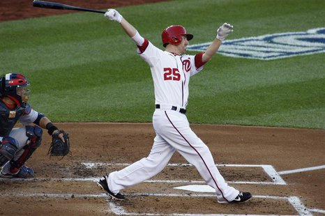Washington Nationals' Adam LaRoche hits a solo home run against the St. Louis Cardinals during the second inning in Game 4 of their MLB NLDS