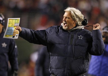 Dallas Cowboys defensive coordinator Rob Ryan rips off his head set while protesting a penalty against the Cowboys late in the second half o