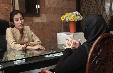 Maryam Suheyl, a marriage and family therapist, meets her client to discuss marital issues at her office in Lahore December 26, 2012. Pakist