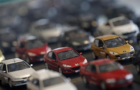 Peugeot miniature model cars are lined-up at French carmaker PSA Peugeot Citroen headquarters store in Paris, November 5, 2012. REUTERS/Chri