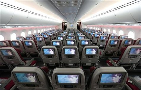 Seats and screens are seen in the economy class cabin of Qatar Airways new Boeing 787 Dreamliner are seen after it arrived on it's inaugural