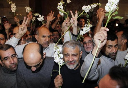 Iranians released by Syrian rebels arrive at a hotel in Damascus January 9, 2013. Forty eight Iranians released by Syrian rebels in exchange