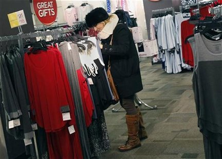 A woman shops for jeans at a J.C. Penney store in New York November 27, 2012. REUTERS/Shannon Stapleton