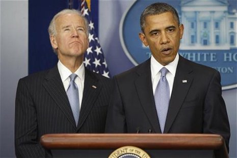 U.S. President Barack Obama delivers remarks next to Vice President Joe Biden (L) after the House of Representatives acted on legislation in