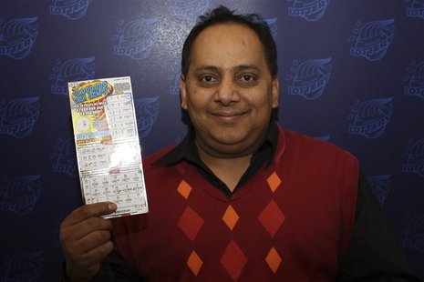 Urooj Khan is pictured holding his winning lottery ticket in this undated handout photo from the Illinois Lottery. Khan died of cyanide pois