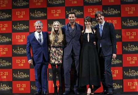 Producer Cameron Mackintosh, cast members Amanda Michelle Seyfried, Hugh Jackman and Anne Hathaway, and director Tom Hooper (L-R) pose at a