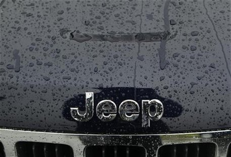 A wet Jeep logo and grill is shown at the Criswell Chrysler-Dodge-Jeep-Fiat-Ram truck dealership in Gaithersburg, Maryland October 2, 2012.
