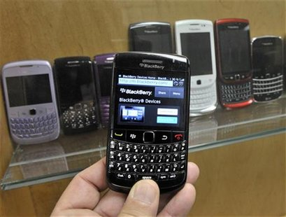 A BlackBerry device is shown in front of products displayed in a glass cabinet at the Research in Motion offices in Waterloo November 14, 20