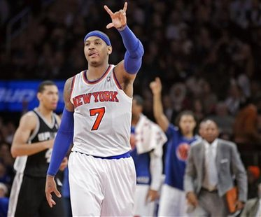 New York Knicks' forward Carmelo Anthony (7) celebrates a three-point shot against the San Antonio Spurs in the third quarter of their NBA b