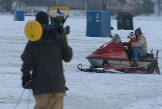 Snowmobile driving on the ice. (courtesy of FOX 11).