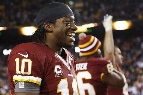 Washington Redskins quarterback Robert Griffin III (10) smiles on the sideline as time runs out in his team's victory over the Dallas Cowboy