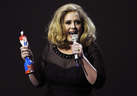 Adele speaks as she holds her award for best British female solo artist during the BRIT Music Awards at the O2 Arena in London February 21,