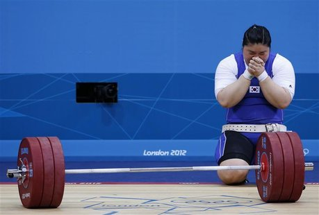 South Korea's Jang Mi-Ran reacts after failing to lift on her third attempt in the women's +75kg group A clean and jerk weightlifting compet