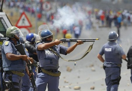 Police fire on demonstrators during a strike by farm workers at De Doorns on the N1 highway, linking Cape Town and Johannesburg, January 9,